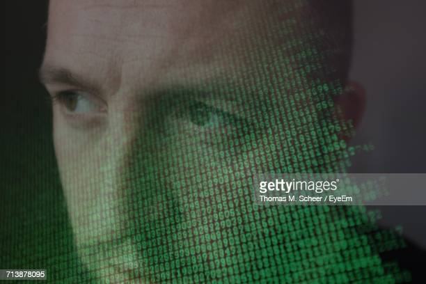 Computer Screen With Binary Code Over Mans Face