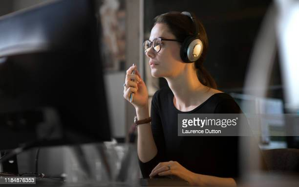 computer sound editor woman - headphones stock pictures, royalty-free photos & images