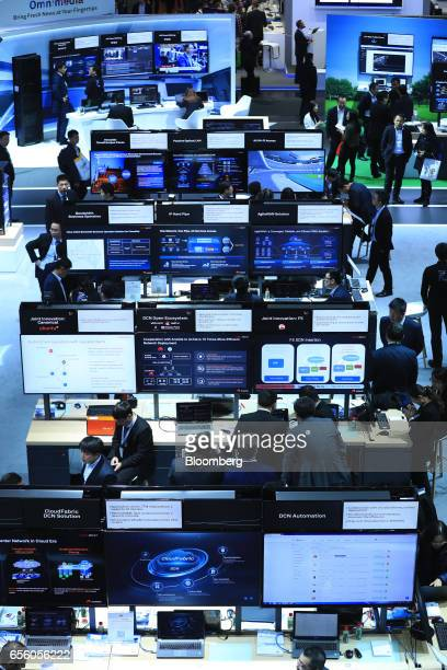Computer system infographics sit on display screens in an exhibition hall at the CeBIT 2017 tech fair in Hannover Germany on Tuesday March 21 2017...