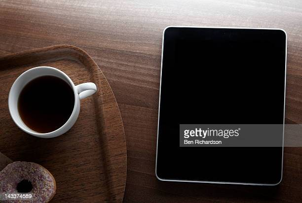Computer Tablet with tray of coffee