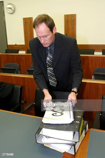 Computer technician Armin Meiwes aged 42 is seen attending to case notes at the prelude to Germany's first cannabalism trial held before the regional...