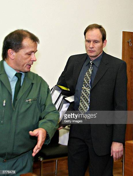 Computer technician Armin Meiwes aged 42 is seen entering the court at the prelude to Germany's first cannabalism trial held before the regional...