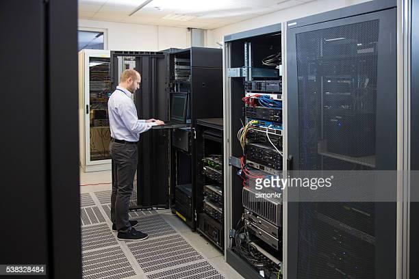 Computer technician working on laptop