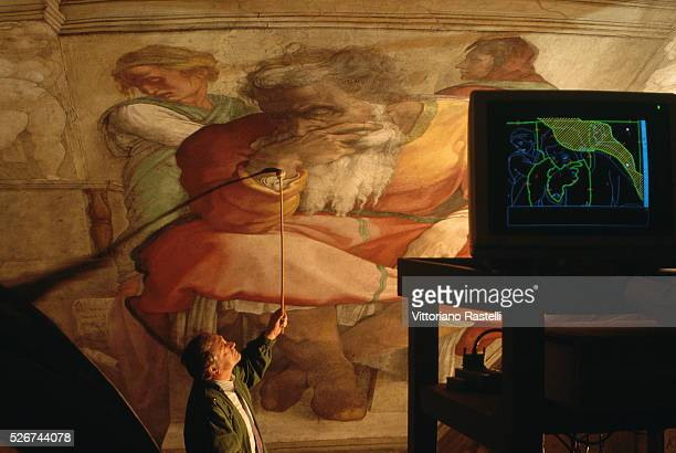 Computer technology is used to assist in the restoration of Michaelangelo's frescoes in the Sistine Chapel Rome Italy | Part of Fresco Cycle at...