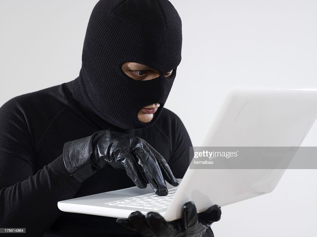 Computer Thief : Stock Photo