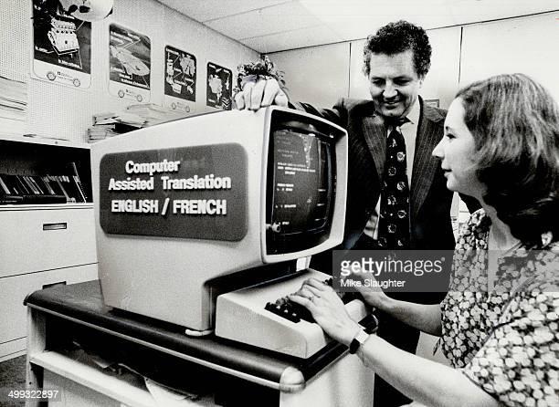 Computer translation Rene Ferland supervisor of French translation at General Motors in Oshawa watches as linguistic coder Jackie DumasMazar punches...