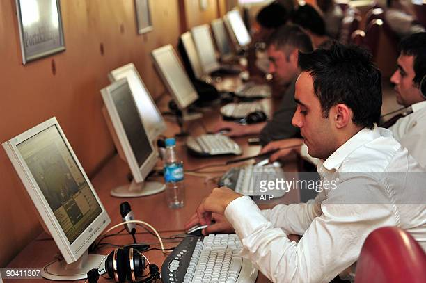 Computer users are pictured in an internet cafe in Istanbul on September 3 2009 where governmental censorship has banned websites including the video...