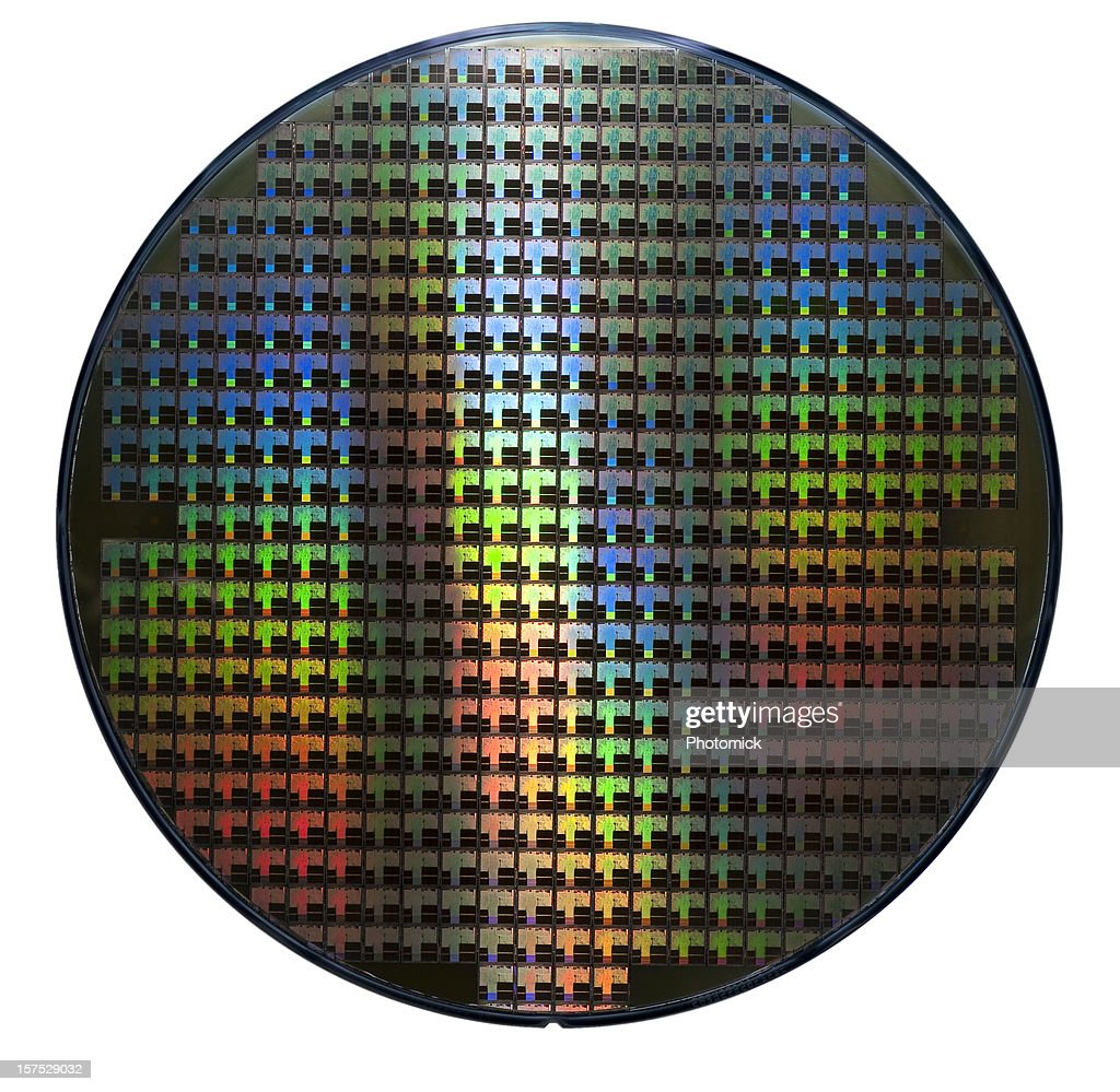 Computer wafer showing rainbow color patterns : Stock Photo
