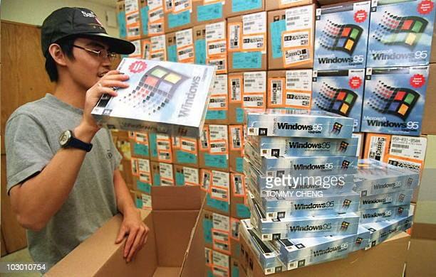 A computer wholesale distributor piles up the newly arrived Window 95 software 23 August from the US Hong Kong retail shops are preparing for the...