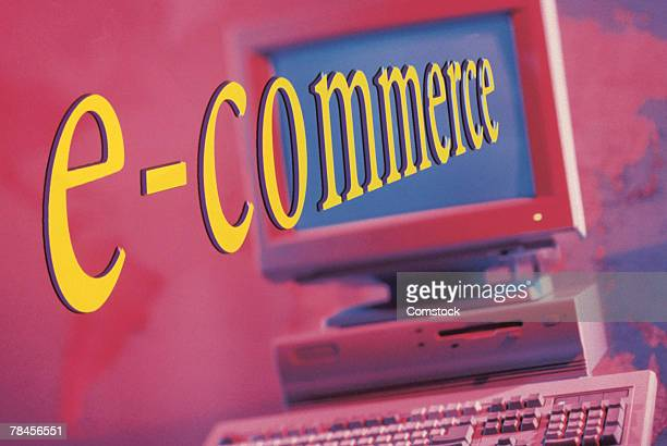 Computer with e-commerce text emerging from screen
