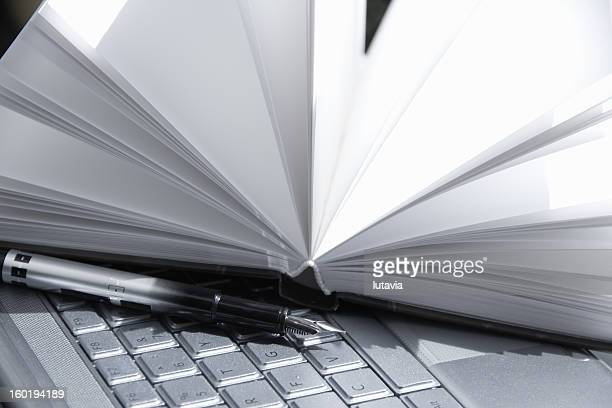 computer with notebook and a pen - lutavia stock pictures, royalty-free photos & images