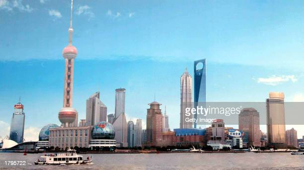A computerenhanced photograph shows a revised design for a Shanghai World Financial Centre designed by Forest Overseas Co a wholly owned subsidiary...