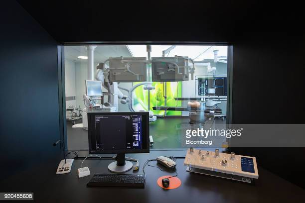 A computerized tomography scanner machine control room sits on display inside the Siemens AG Healthineers showroom in Forchheim Germany on Wednesday...