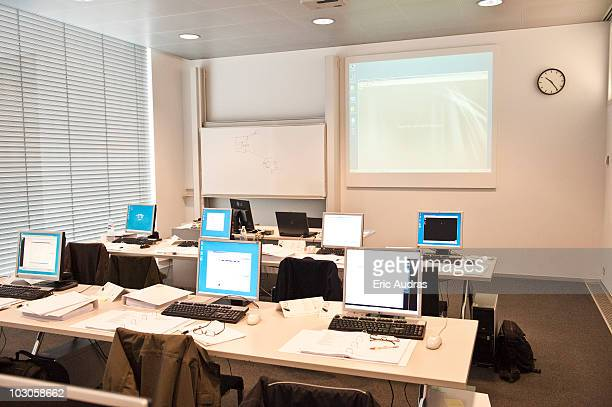 Computers on tables in a classroom