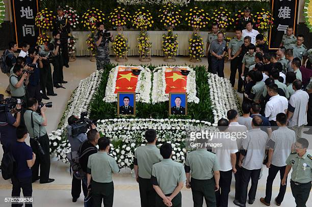 Comrades and families of the Chinese UN peacekeepers killed in a recent attack in South Sudan attend the farewell ceremony at the funeral parlor on...