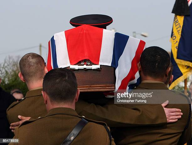 Comrades carry the coffin of Sapper Mark Quinsey who was murdered in Northern Ireland as the funeral cortege arrives at Immanuel Church in Highters...