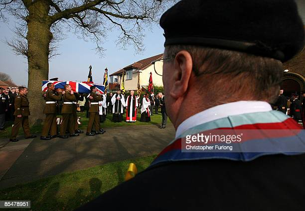 Comrades carry the coffin of Sapper Mark Quinsey who was murdered in Northern Irelandas the funeral cortege arrives at Immanuel Church in Highters...