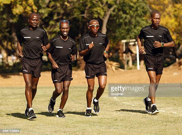 David gatebe pictures and photos getty images 2016 comrades marathon winner david gatebe and his teammates peter gaebetse gift kelehe and gordon lesetedi negle Choice Image