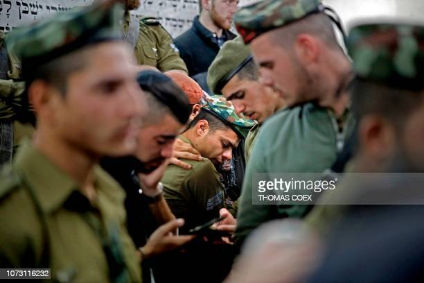Comrades of killed Israeli soldier Yosef Cohen mourn during his funeral in Jerusalem on December 14 2018 Two Israeli soldiers were killed yesterday...
