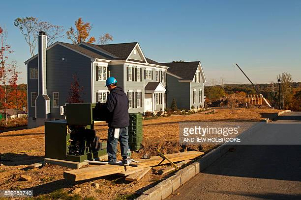Con Edison worker installing electricity in a new housing development for new homes being built in Westchester County New York Housing starts have...