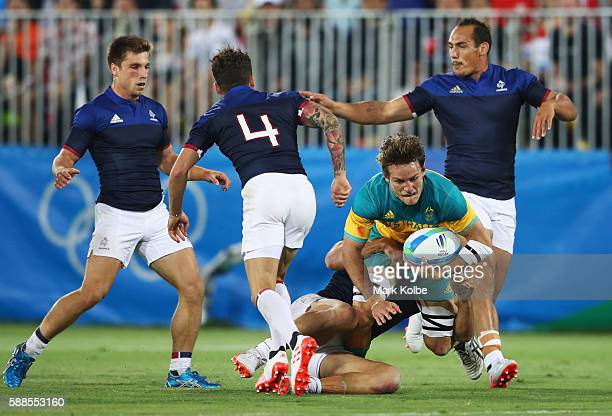 Con Foley of Australia attempts to break through the France defence during the Men's Rugby Sevens placing 78 match between France and Australia on...