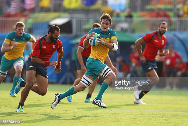Con Foley of Australia breaks through to score a try during the Men's Rugby Sevens Pool B match between Australia and Spain on Day 4 of the Rio 2016...