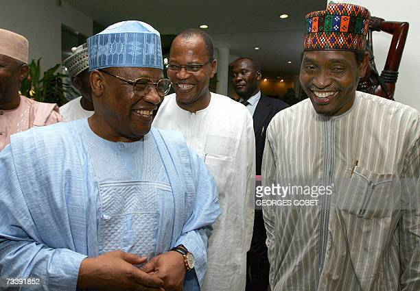 Former Nigerian President Ibrahim Babangida and Commission President of the Economic Community of West African States Mohammed Ibn Chambas with an...