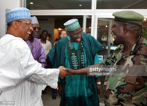 Nigeria's former military ruler Ibrahim Babangida , mediator for the Economic Community of the West African States in the Guinean crisis shakes hands...