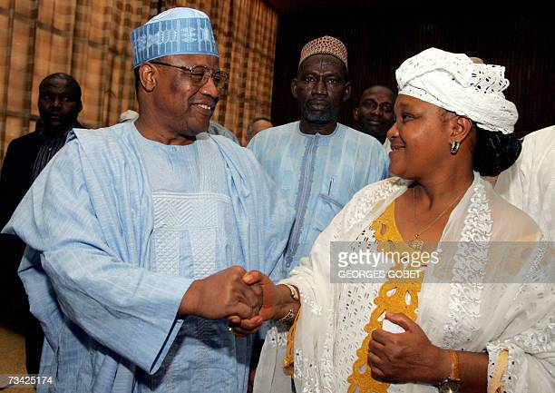 Rabiatou Serah Diallo secretary general of the National Workers Confederation of Guinea shakes hands with Former Nigerian president and leader of the...