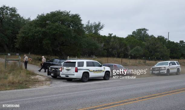 Conal County Sheriffs guard the entrance to the home of Devin Kelley the Texas shooting suspect in New Braunfels Texas on November 6 2017 A gunman...