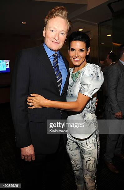 Conan O'Brien and Angie Harmon attend the TBS / TNT Upfront 2014 at The Theater at Madison Square Garden on May 14, 2014 in New York City....