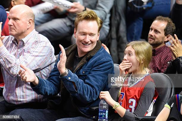Conan O'Brien and his daughter Neve O'Brien attend a basketball game between the Houston Rockets and the Los Angeles Clippers at Staples Center on...