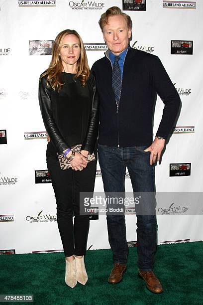 Conan O'Brien and Liza Powel attend the USIreland alliance preAcademy Awards event held at Bad Robot on February 27 2014 in Santa Monica California