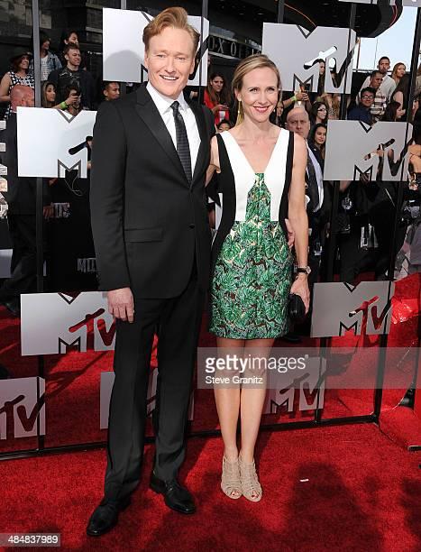 Conan O'Brien and Liza Powel O'Brien arrives at the 2014 MTV Movie Awards at Nokia Theatre LA Live on April 13 2014 in Los Angeles California