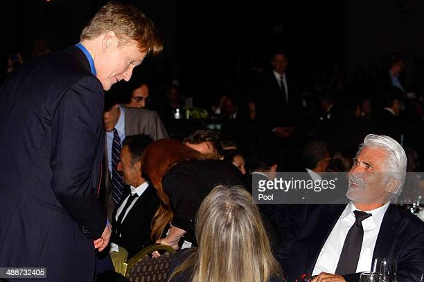 Conan O'Brien chats with Barbra Streisand and her husband James Brolin at the Shoah Foundation gala at the Hyatt Regency Century Plaza Hotel on May 7...