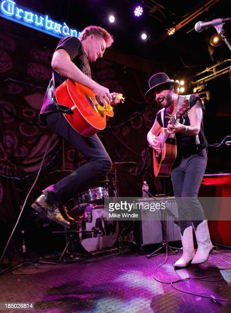 Conan O'Brien performs onstage with Langhorne Slim The Law at the Troubadour on October 16 2013 in West Hollywood California