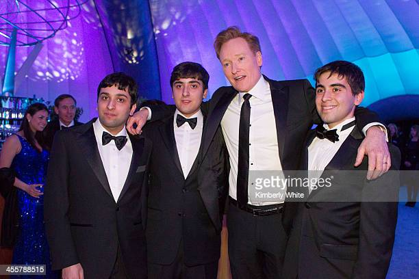 Conan O'Brien poses for a photograph with fans at NASA Ames Research Center on December 12 2013 in Mountain View California