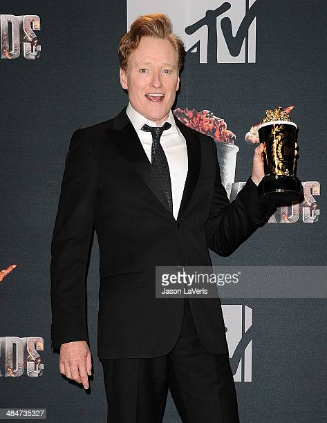 Conan O'Brien poses in the press room at the 2014 MTV Movie Awards at Nokia Theatre LA Live on April 13 2014 in Los Angeles California