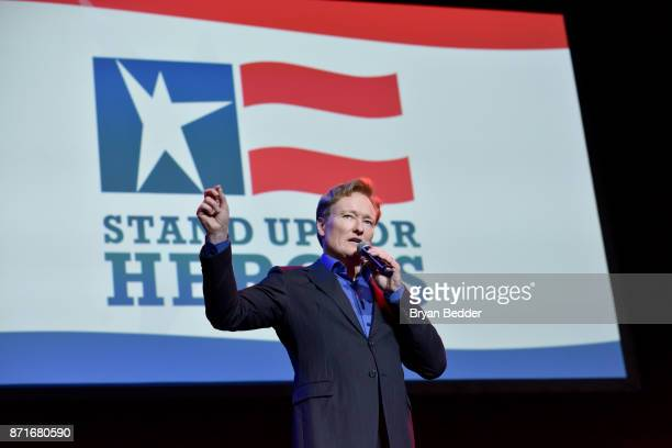 Conan O'Brien speaks onstage during the 11th Annual Stand Up for Heroes Event presented by The New York Comedy Festival and The Bob Woodruff...