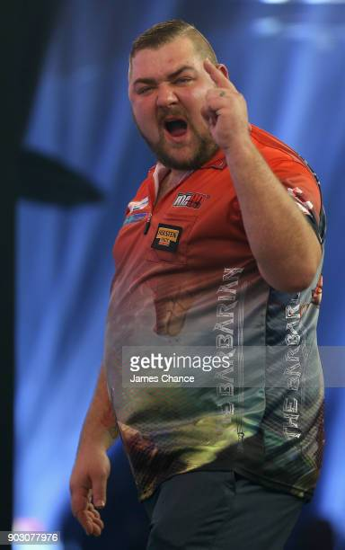 Conan Whitehead of England celebrates while playing Cameron Menzies during the First Round of the BDO World Darts Championship at Lakeside Country...