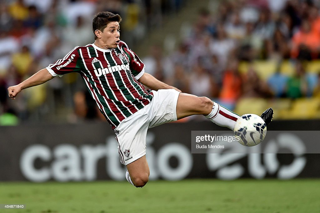 Conca of Fluminense struggles for the ball during a match between Fluminense and Cruzeiro as part of Brasileirao Series A 2014 at Maracana Stadium on September 07, 2014 in Rio de Janeiro, Brazil.