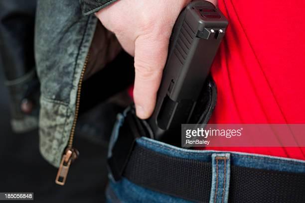 Oculto sacar de un arma de fuego de transporte dentro de la funda con pretina