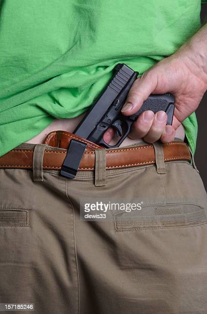 concealed carry handgun - concealed carry stock photos and pictures