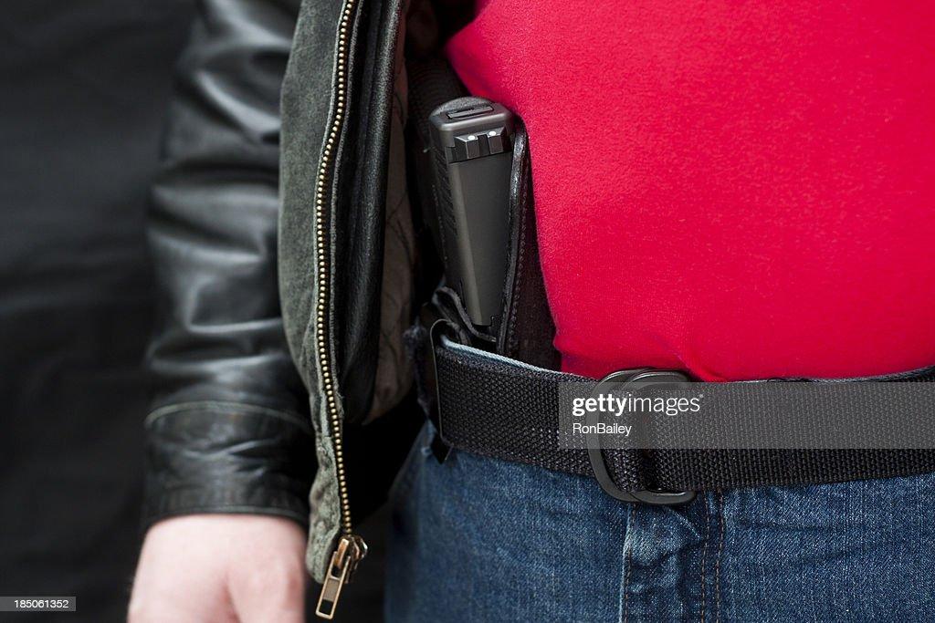 隠れた Firearm のジャケット : ストックフォト