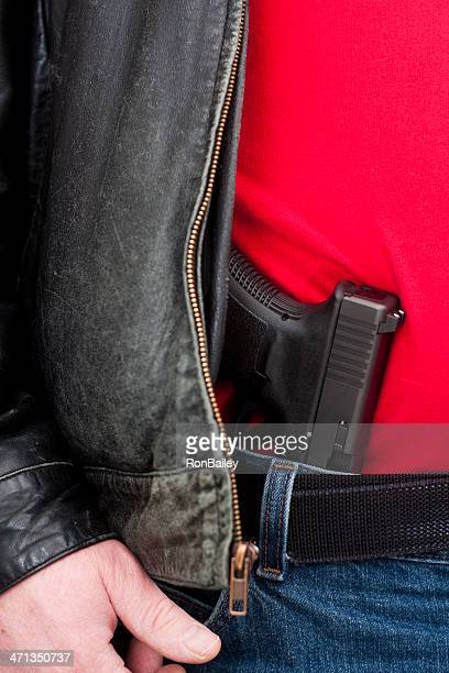 concealed (mexican carry) firearm under jacket - concealed carry stock photos and pictures