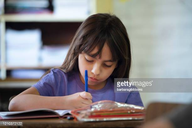concentrated and fun on your first day of school - state school stock pictures, royalty-free photos & images