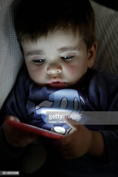 Concentrated Baby Boy Using Digital Tablet