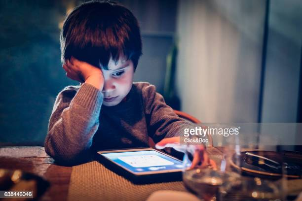 Concentrated boy with a tablet - New technologies
