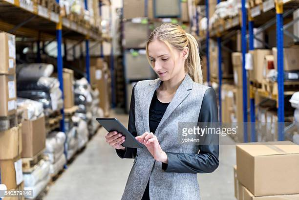 Concentrated business woman searching on tablet