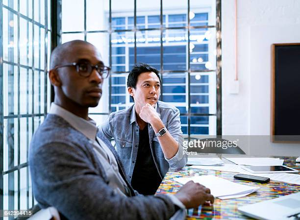 Concentrated businessmen listening during meeting